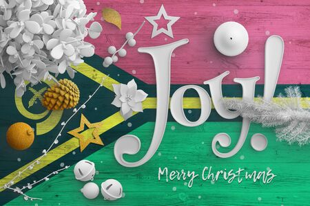 Vanuatu flag on wooden table with joy text. Christmas and new year background, celebration national concept with white decor. Foto de archivo