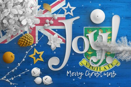 British Virgin Islands flag on wooden table with joy text. Christmas and new year background, celebration national concept with white decor.
