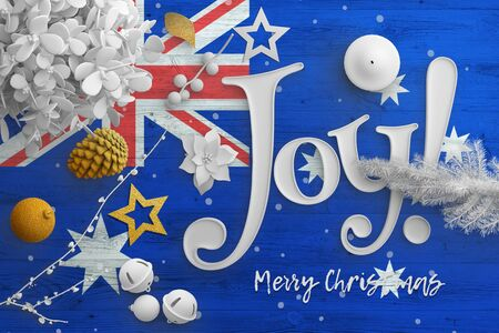 Australia flag on wooden table with joy text. Christmas and new year background, celebration national concept with white decor.