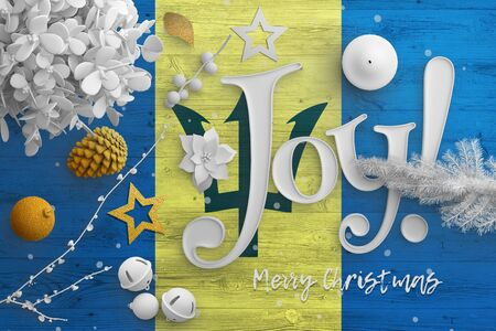 Barbados flag on wooden table with joy text. Christmas and new year background, celebration national concept with white decor.
