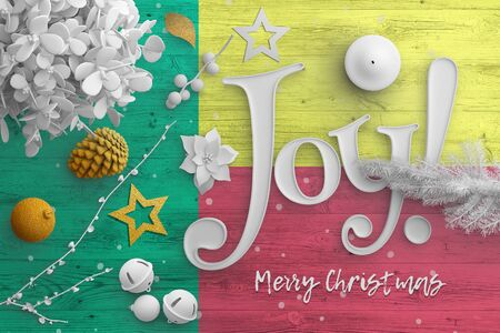 Benin flag on wooden table with joy text. Christmas and new year background, celebration national concept with white decor.