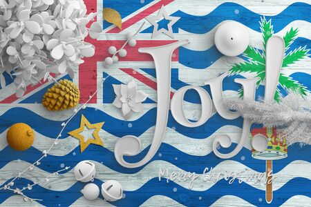 British Indian Ocean Territory flag on wooden table with joy text. Christmas and new year background, celebration national concept with white decor. Foto de archivo