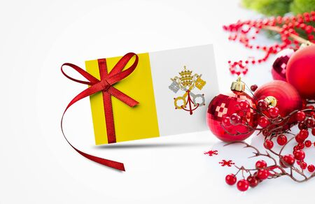 Vatican City flag on new year invitation card with red christmas ornaments concept. National happy new year composition.