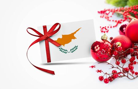 Cyprus flag on new year invitation card with red christmas ornaments concept. National happy new year composition. Standard-Bild