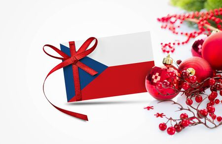 Czech Republic flag on new year invitation card with red christmas ornaments concept. National happy new year composition.