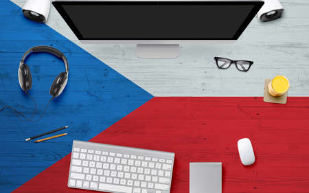 Czech Republic flag background with headphone,computer keyboard and mouse on national office desk table.Top view with copy space.Flat Lay.