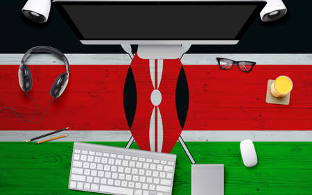 Kenya flag background with headphone,computer keyboard and mouse on national office desk table.Top view with copy space.Flat Lay.