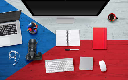 Czech Republic flag background with headphone,camera, notebook and mouse on national office desk table.Top view with copy space.Flat Lay. 스톡 콘텐츠
