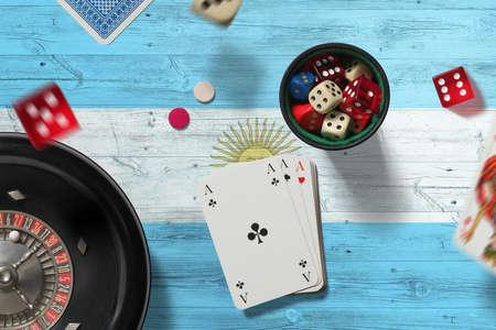 Argentina casino theme. Aces in poker game, cards and chips on red table with national flag background. Gambling and betting.