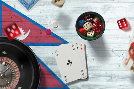 Nepal casino theme. Aces in poker game, cards and chips on red table with national flag background. Gambling and betting.