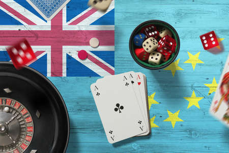 Tuvalu casino theme. Aces in poker game, cards and chips on red table with national flag background. Gambling and betting.