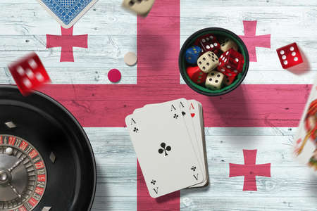 Georgia casino theme. Aces in poker game, cards and chips on red table with national flag background. Gambling and betting.