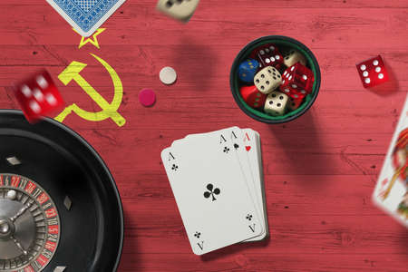 Soviet Union casino theme. Aces in poker game, cards and chips on red table with national flag background. Gambling and betting.