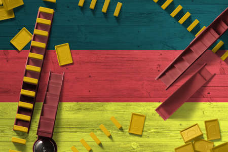 Germany flag with national background with dominoes on wooden table. Top view. Concept of game.