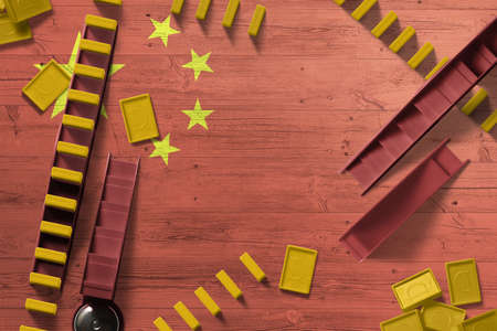 China flag with national background with dominoes on wooden table. Top view. Concept of game. 免版税图像