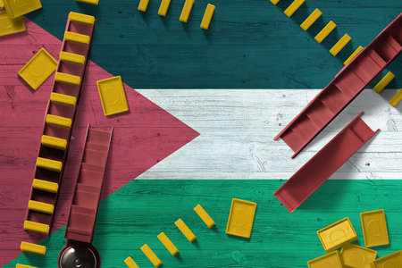 Jordan flag with national background with dominoes on wooden table. Top view. Concept of game.