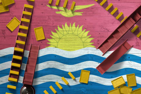 Kiribati flag with national background with dominoes on wooden table. Top view. Concept of game.