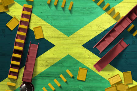 Jamaica flag with national background with dominoes on wooden table. Top view. Concept of game.