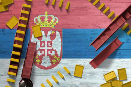Serbia flag with national background with dominoes on wooden table. Top view. Concept of game.
