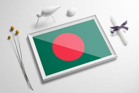 Bangladesh flag in wooden frame on table. White natural soft concept, national celebration theme. Stock Photo
