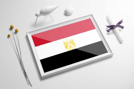 Egypt flag in wooden frame on table. White natural soft concept, national celebration theme.