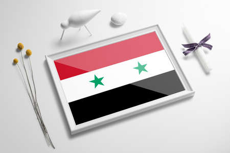Syria flag in wooden frame on table. White natural soft concept, national celebration theme. Banco de Imagens