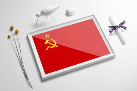 Soviet Union flag in wooden frame on table. White natural soft concept, national celebration theme.