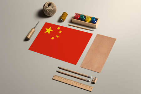 China calligraphy concept, accessories and tools for beautiful handwriting, pencils, pens, ink, brush, craft paper and cardboard crafting on wooden table. 写真素材