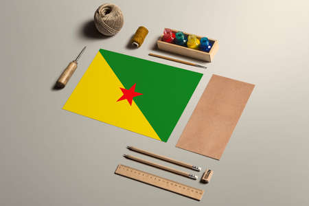 French Guiana calligraphy concept, accessories and tools for beautiful handwriting, pencils, pens, ink, brush, craft paper and cardboard crafting on wooden table. 版權商用圖片