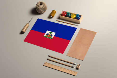 Haiti calligraphy concept, accessories and tools for beautiful handwriting, pencils, pens, ink, brush, craft paper and cardboard crafting on wooden table. 版權商用圖片