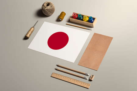 Japan calligraphy concept, accessories and tools for beautiful handwriting, pencils, pens, ink, brush, craft paper and cardboard crafting on wooden table.