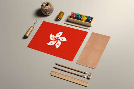 Hong Kong calligraphy concept, accessories and tools for beautiful handwriting, pencils, pens, ink, brush, craft paper and cardboard crafting on wooden table.