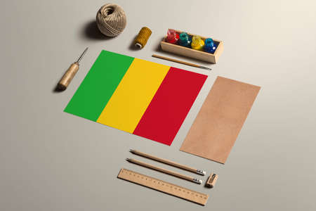 Mali calligraphy concept, accessories and tools for beautiful handwriting, pencils, pens, ink, brush, craft paper and cardboard crafting on wooden table. 免版税图像