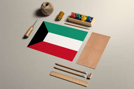 Kuwait calligraphy concept, accessories and tools for beautiful handwriting, pencils, pens, ink, brush, craft paper and cardboard crafting on wooden table.