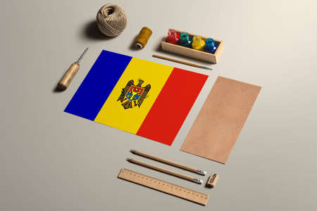 Moldova calligraphy concept, accessories and tools for beautiful handwriting, pencils, pens, ink, brush, craft paper and cardboard crafting on wooden table.