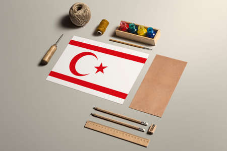 Northern Cyprus calligraphy concept, accessories and tools for beautiful handwriting, pencils, pens, ink, brush, craft paper and cardboard crafting on wooden table. 免版税图像