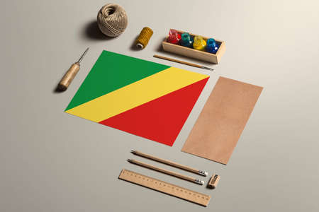 Republic Of The Congo calligraphy concept, accessories and tools for beautiful handwriting, pencils, pens, ink, brush, craft paper and cardboard crafting on wooden table. 写真素材