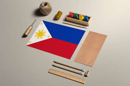 Philippines calligraphy concept, accessories and tools for beautiful handwriting, pencils, pens, ink, brush, craft paper and cardboard crafting on wooden table. 写真素材