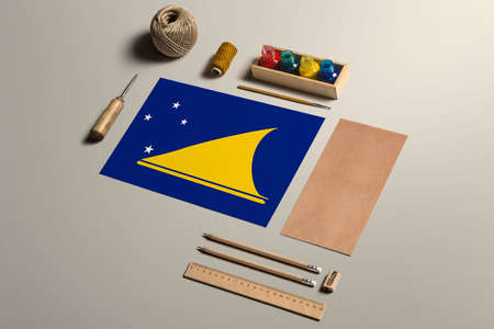 Tokelau calligraphy concept, accessories and tools for beautiful handwriting, pencils, pens, ink, brush, craft paper and cardboard crafting on wooden table.