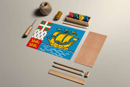 Saint Pierre And Miquelon calligraphy concept, accessories and tools for beautiful handwriting, pencils, pens, ink, brush, craft paper and cardboard crafting on wooden table. 写真素材