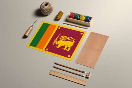 Sri Lanka calligraphy concept, accessories and tools for beautiful handwriting, pencils, pens, ink, brush, craft paper and cardboard crafting on wooden table.
