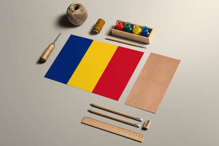 Romania calligraphy concept, accessories and tools for beautiful handwriting, pencils, pens, ink, brush, craft paper and cardboard crafting on wooden table.