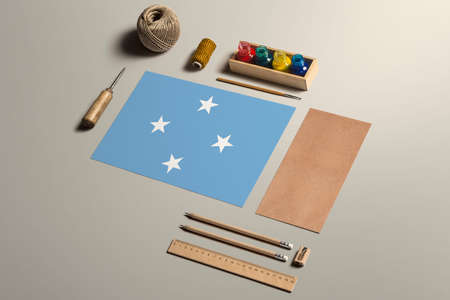 Micronesia calligraphy concept, accessories and tools for beautiful handwriting, pencils, pens, ink, brush, craft paper and cardboard crafting on wooden table. 写真素材