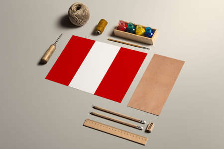 Peru calligraphy concept, accessories and tools for beautiful handwriting, pencils, pens, ink, brush, craft paper and cardboard crafting on wooden table.