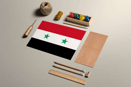 Syria calligraphy concept, accessories and tools for beautiful handwriting, pencils, pens, ink, brush, craft paper and cardboard crafting on wooden table. 免版税图像