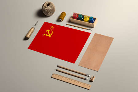 Soviet Union calligraphy concept, accessories and tools for beautiful handwriting, pencils, pens, ink, brush, craft paper and cardboard crafting on wooden table.