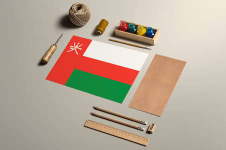 Oman calligraphy concept, accessories and tools for beautiful handwriting, pencils, pens, ink, brush, craft paper and cardboard crafting on wooden table. 版權商用圖片