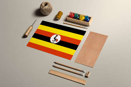 Uganda calligraphy concept, accessories and tools for beautiful handwriting, pencils, pens, ink, brush, craft paper and cardboard crafting on wooden table. 版權商用圖片