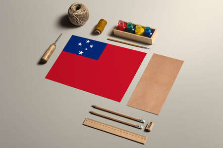 Samoa calligraphy concept, accessories and tools for beautiful handwriting, pencils, pens, ink, brush, craft paper and cardboard crafting on wooden table. 写真素材