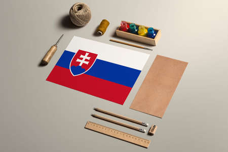 Slovakia calligraphy concept, accessories and tools for beautiful handwriting, pencils, pens, ink, brush, craft paper and cardboard crafting on wooden table. 写真素材